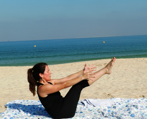 Julie Campos Farmer doing yoga on the Umm Suqeim beach in Dubai