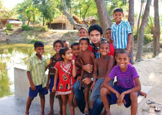 Bobby posing with local kids at Sunderban