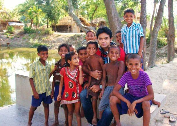 Bobby posing with local kids at Sunderban