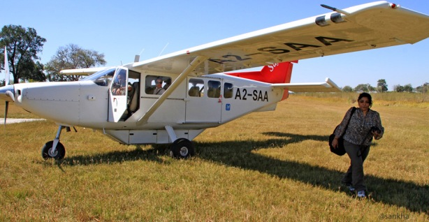 Chandrani in front of a 6-seater bush plane in Botswana