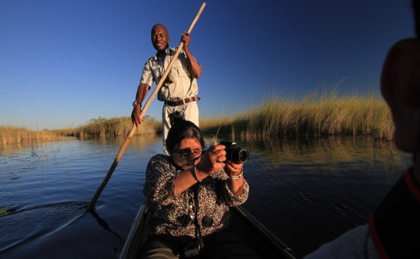 Chandrani rides a Mokoro in crocodile and hippo infested waters in Botswana