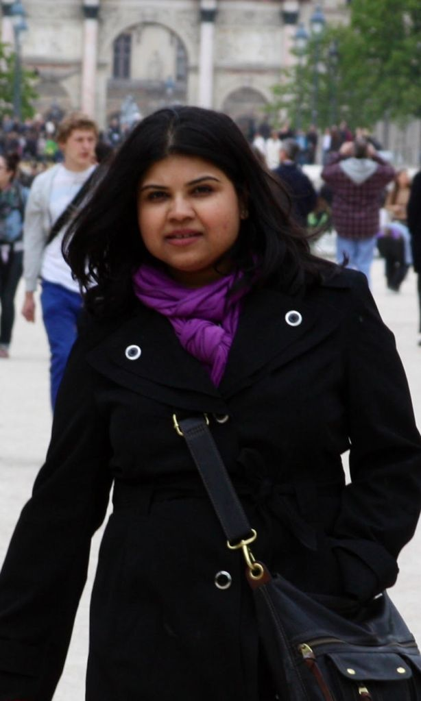 Sunny Sarkar in a black winter jacket which she has brightened up with a violet scarf